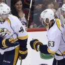 Nashville Predators' Filip Forsberg (9) tosses the puck to Mike Ribeiro (63) after James Neal (18) scored against the Winnipeg Jets during the third period of an NHL hockey game Friday, Oct. 17, 2014, in Winnipeg, Manitoba The Associated Press