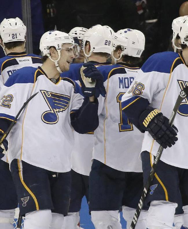 St. Louis Blues defenseman Kevin Shattenkirk (22) celebrates with teammates after the Blues defeated the New York Rangers 2-1 in an NHL hockey game at Madison Square Garden in New York, Thursday, Jan. 23, 2014. Shattenkirk scored the tie-breaking goal on a power play in the third period