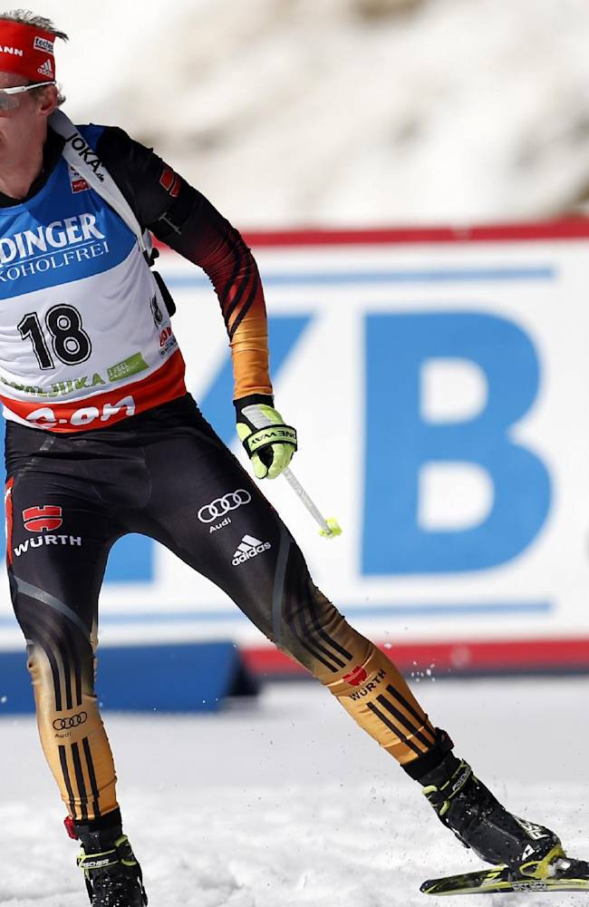 Germany's Daniel Boehm competes in the men's 15km mass start at the biathlon World Cup competition in Pokljuka, Slovenia, Sunday, March 9, 2014
