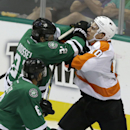 Philadelphia Flyers center Brayden Schenn (10) and Dallas Stars left wing Antoine Roussel (21) mix it up during the third period of an NHL hockey game Saturday, Oct. 18, 2014, in Dallas. The Flyers won 6-5 in overtime The Associated Press