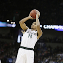 Michigan State's Gary Harris (14) shoots a jump shot during the third-round game of the NCAA men's college basketball tournament against Harvard in Spokane, Wash., Saturday, March 22, 2014.(AP Photo/Young Kwak)