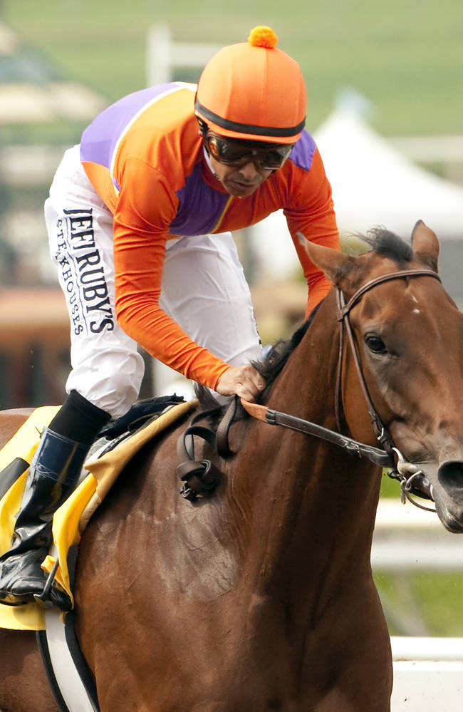 In this image provided by Benoit Photo, Beholder, with Mike Smith aboard, wins the Grade I Zenyatta Stakes horse race Saturday, Sept. 27, 2014, at Santa Anita Park in Arcadia, Calif.