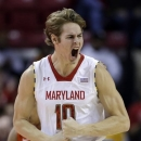 Maryland guard Jake Layman reacts after scoring a three-pointer in the first half of an NCAA college basketball game against Virginia Tech in College Park, Md., Saturday, Jan. 5, 2013. (AP Photo/Patrick Semansky)