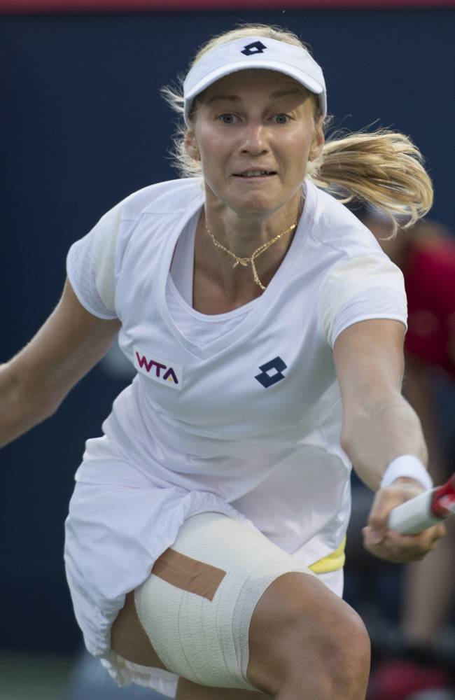 Ekaterina Makarova, of Russia, returns to Coco Vandeweghe, of the United States, during the Rogers Cup tennis tournament Friday, Aug. 8, 2014, in Montreal