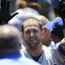 Texas Rangers' Mike Napoli celebrates with teammates after his second home run in a baseball game against the Los Angeles Angels, in the third inning Saturday, July 21, 2012, in Anaheim, Calif. (AP Photo/Reed Saxon)