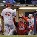 St. Louis Cardinals' Matt Holliday is congratulated in the dugout after hitting a home run during the ninth inning of a baseball game against the Milwaukee Brewers Tuesday, April 15, 2014, in Milwaukee The Associated Press