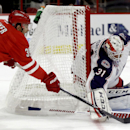 Carolina Hurricanes' Patrick Dwyer (39) is blocked by Columbus Blue Jackets' Anton Forsberg (31), of Sweden, during the first period of an NHL preseason hockey game in Raleigh, N.C., Sunday, Sept. 21, 2014 The Associated Press