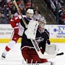 Columbus Blue Jackets goalie Sergi Bobrovsky, right, of Russia, stops a shot in front of Detroit Red Wings' Justin Abdelkader in the first period of an NHL hockey game in Columbus, Ohio, Tuesday, March 11, 2014. Columbus won 4-1. (AP Photo/Paul Vernon)