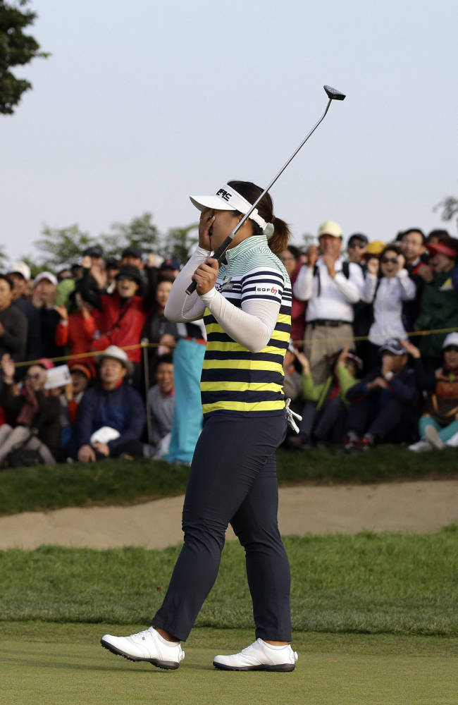 Amy Yang of South Korea celebrates after her putt in a playoff winning the KEB Hana Bank Championship golf tournament at Sky72 Golf Club in Incheon, west of Seoul, South Korea, Sunday, Oct. 20, 2013