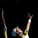 Britain's Andy Murray serves to France's Jeremy Chardy during their quarterfinal match at the Australian Open tennis championship in Melbourne, Australia, Wednesday, Jan. 23, 2013. (AP Photo/ Cameron Spencer ,Pool)