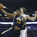 Utah Jazz center Derrick Favors (15) grabs a rebound in front of New Orleans Pelicans forward Luke Babbitt (8) in the first half of an NBA basketball game in New Orleans, Friday, March 28, 2014 The Associated Press