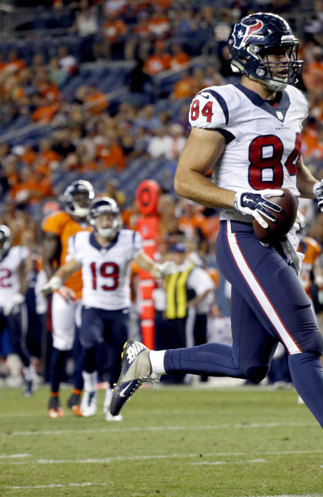 Houston Texans tight end Ryan Griffin (84) scores against the Denver Broncos during the second half of an NFL preseason football game, Saturday, Aug. 23, 2014, in Denver