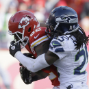 Seattle Seahawks cornerback Richard Sherman (25) grabs the face mask of Kansas City Chiefs wide receiver Dwayne Bowe (82) in the second half of an NFL football game in Kansas City, Mo., Sunday, Nov. 16, 2014 The Associated Press