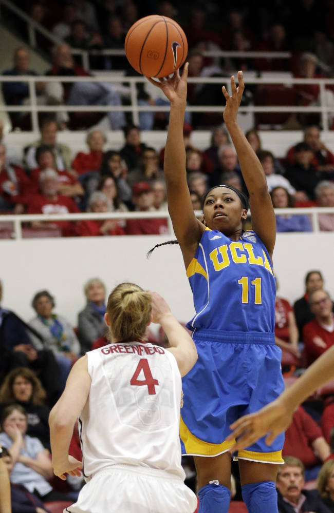 UCLA forward Atonye Nyingifa (11) shoots over Stanford forward Taylor Greenfield (4) during the second half of an NCAA college basketball game on Friday, Jan. 24, 2014, in Stanford, Calif