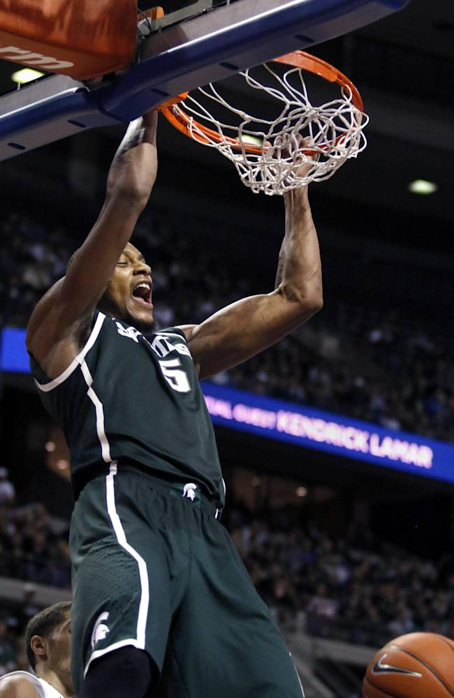 Michigan State's Adreian Payne dunks during the second half of an NCAA college basketball game against Oakland, Saturday, Dec. 14, 2013, in Auburn Hills, Mich. Michigan State won 67-63
