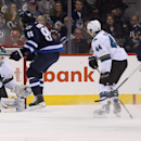 San Jose Sharks goaltender Antti Niemi (31) can't stop a goal by Winnipeg Jets' Andrew Ladd (16) as he is screened by Mathieu Perreault (85) with Sharks' Marc-Edouard Vlasic (44) also in front of the net during the first period of an NHL hockey game Monda
