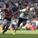 West Ham United's Mark Noble, left, competes for the ball with Tottenham Hotspur's Younes Kaboul during their English Premier League soccer match at Upton Park, London, Saturday, Aug. 16, 2014