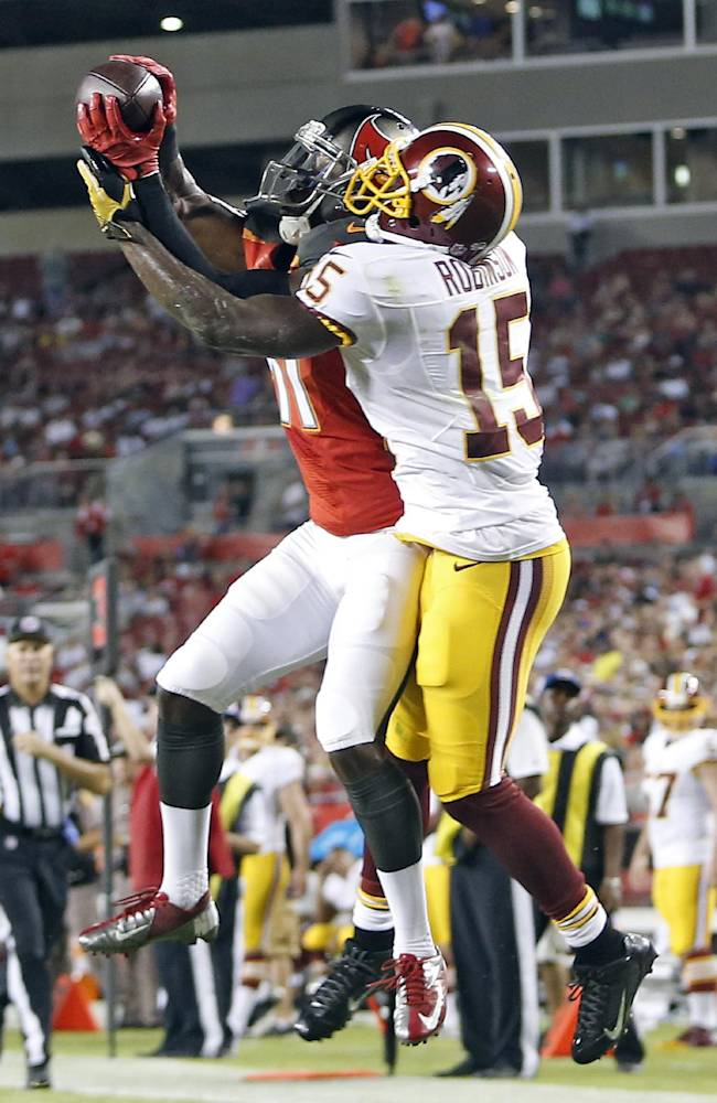 Tampa Bay Buccaneers defensive back Keith Lewis (41) intercepts a pass intended for Washington Redskins wide receiver Aldrick Robinson (15) during the second quarter of an NFL preseason football game Thursday, Aug. 28, 2014, in Tampa, Fla