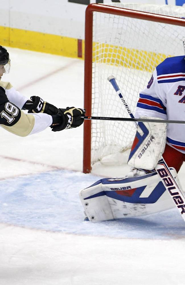 Pittsburgh Penguins' Beau Bennett (19) can't get his stick on a puck in front of New York Rangers goalie Henrik Lundqvist (30) in the first period of game 2 of a second-round NHL playoff hockey series in Pittsburgh Sunday, May 4, 2014
