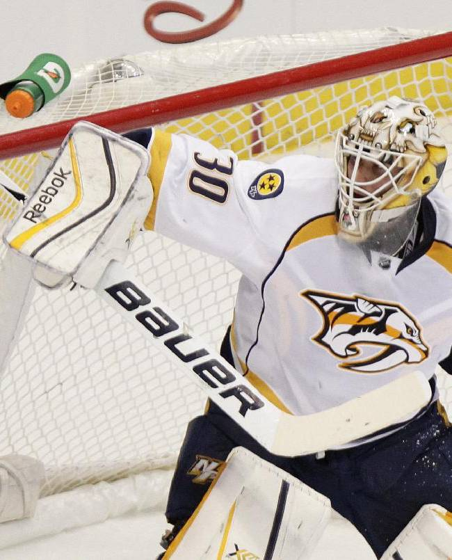Nashville Predators goalie Carter Hutton (30) makes a save during the third period of an NHL hockey game against the Colorado Avalanche on Wednesday, Nov. 6, 2013 in Denver. The Predators won 6-4