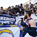 San Diego Chargers free safety Eric Weddle , foreground, runs past fans after his team defeated the New York Jets 31-0 in an NFL football game Sunday, Oct. 5, 2014, in San Diego The Associated Press