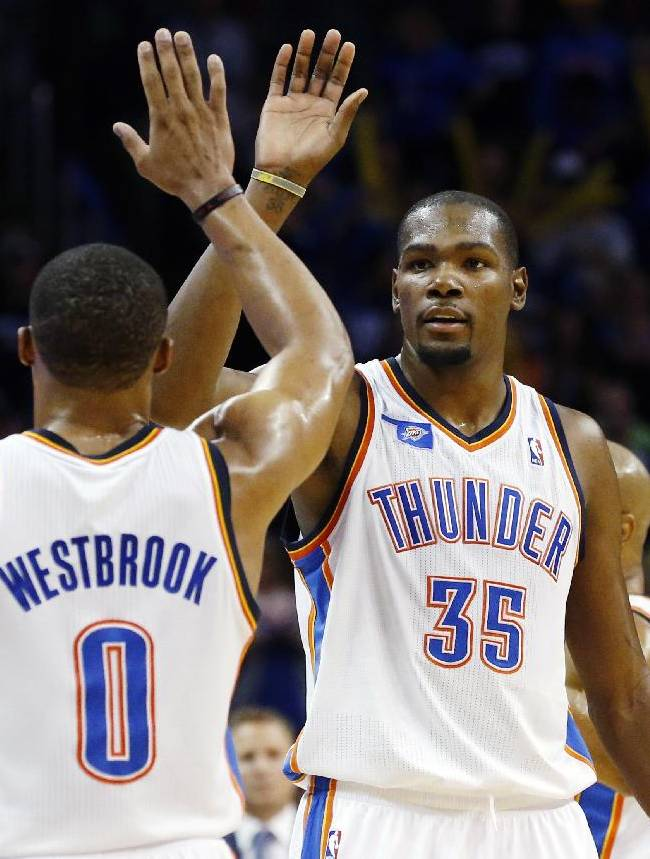 Oklahoma City Thunder forward Kevin Durant (35) high fives teammate Russell Westbrook in the fourth quarter of an NBA basketball game against the Phoenix Suns in Oklahoma City, Sunday, Nov. 3, 2013. Oklahoma City won 103-96