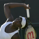 Venus Williams of the United States serves to Madison Brengle of the United States during the women's singles first round match at the All England Lawn Tennis Championships in Wimbledon, London, Monday June 29, 2015. (AP Photo/Tim Ireland)