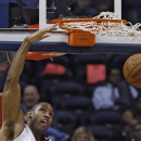 Atlanta Hawks center Al Horford (15) scores in the second half of an NBA basketball game against the Los Angeles Clippers Wednesday, Dec. 4, 2013, in Atlanta. Atlanta won 107-97 The Associated Press