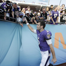 Baltimore Ravens quarterback Joe Flacco celebrates with Ravens fans after they defeated the Miami Dolphins 28-13 in an NFL football game, Sunday, Dec. 7, 2014 in Miami Gardens, Fla The Associated Press