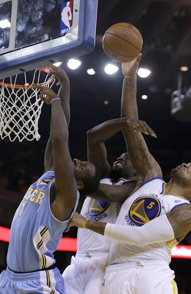 Golden State Warriors' Marreese Speights, right, reaches for a rebound over Denver Nuggets' J.J. Hickson (7) during the second half of an NBA basketball game on Wednesday, Jan. 15, 2014, in Oakland, Calif. At center is Warriors' Draymond Green