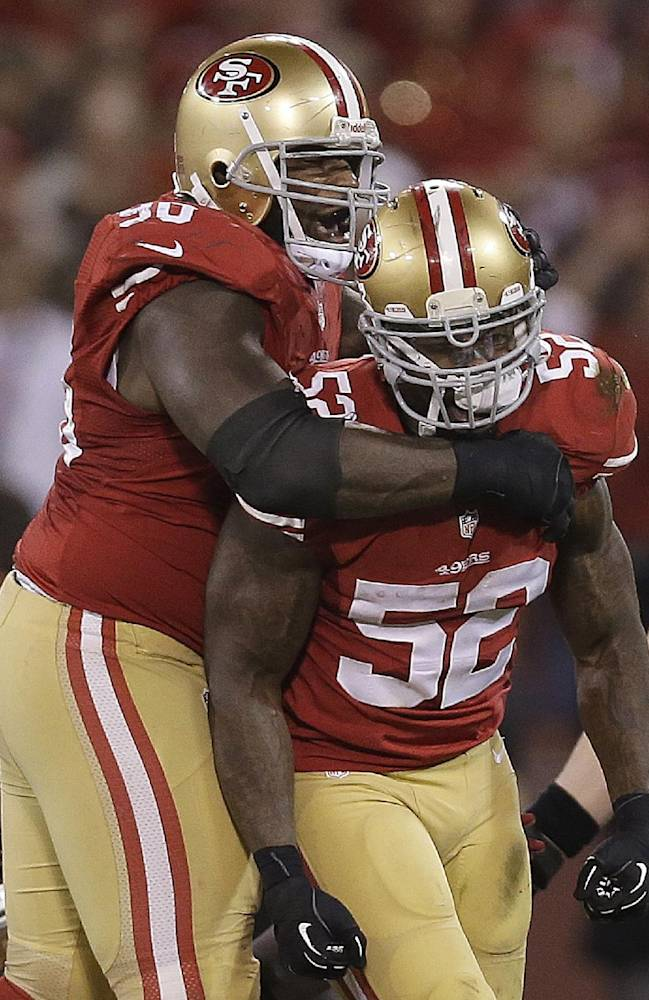 In this Dec. 23, 2013 file photo, San Francisco 49ers' Glenn Dorsey, left, celebrates with linebacker Patrick Willis during the second half of an NFL football game against the Atlanta Falcons in San Francisco