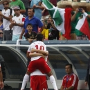 Mexico's Marco Fabian, front, jumps in the arms of a teammate after scoring a goal against Martinique in the first half of a CONCACAF Gold Cup soccer match on Sunday, July 14, 2013, in Denver. (AP Photo/David Zalubowski)