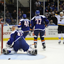 St. Louis Blues center Paul Stastny (26) celebrates after scoring as New York Islanders goalie Jaroslav Halak (41), right wing Michael Grabner (40) and defenseman Brian Strait (37) look on during the third period of an NHL hockey game at Nassau Coliseum