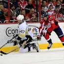 WASHINGTON, DC - MARCH 10: Simon Despres #47 of the Pittsburgh Penguins and Eric Fehr #16 of the Washington Capitals go after the puck during the first period at Verizon Center on March 10, 2014 in Washington, DC. (Photo by Rob Carr/Getty Images)