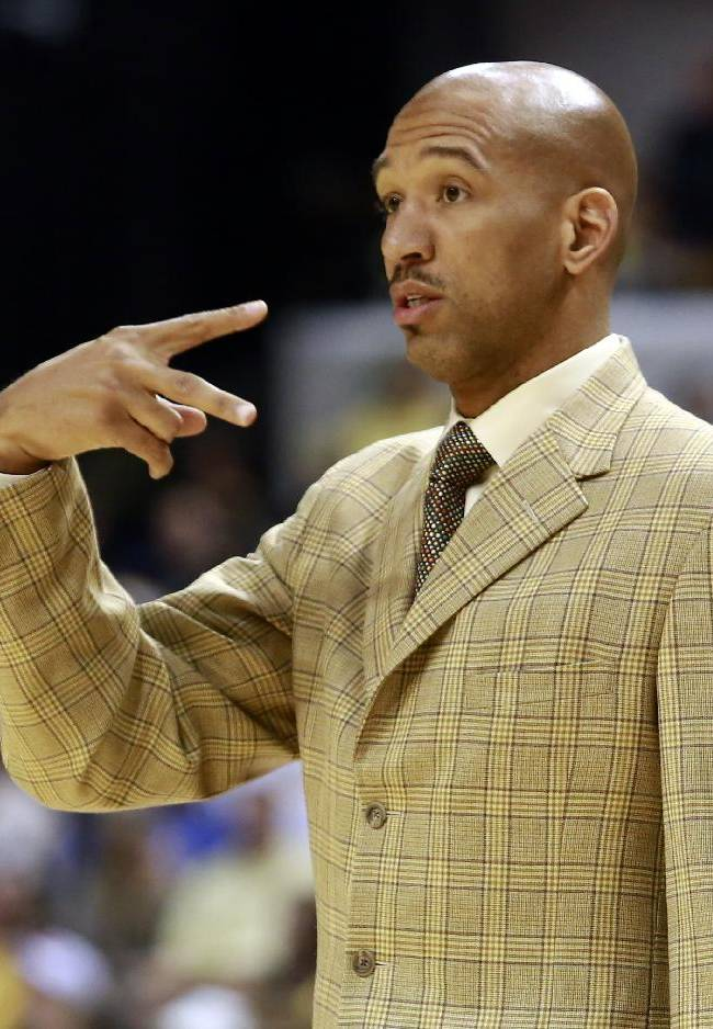 New Orleans Pelicans coach Monty Williams signals to his players during the second half of an NBA basketball game against the Indiana Pacers in Indianapolis, Saturday, Jan. 4, 2014. Indiana won 99-82