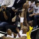 Miami Heat center Chris Bosh (1) and guard Mario Chalmers (15) defend Indiana Pacers center Roy Hibbert (55) during the first half of Game 1 in their NBA basketball Eastern Conference finals playoff series, Wednesday, May 22, 2013 in Miami. (AP Photo/Wilfredo Lee)