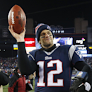 FILE - In this Jan. 10, 2015, file photo,New England Patriots quarterback Tom Brady holds up the game ball after an NFL divisional playoff football game against the Baltimore Ravens in Foxborough, Mass. Brady's four-game suspension for his role in using underinflated footballs during the AFC championship game last season has been upheld by NFL Commissioner Roger Goodell. The league announced the decision Tuesday, July 28, 2015. (AP Photo/Elise Amendola, File)