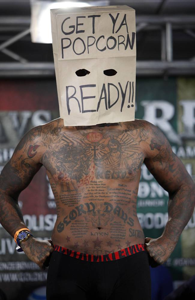Boxer Malik Scott, wearing a mask made from a paper bag, poses for photos as he makes weight during the official weigh-in at the Ruben Rodriguez Coliseum in Bayamon, Puerto Rico, Friday, March 14, 2014. Scott will face WBC Continental Americas Heavyweight Champion Deontay Wilder in tin a Showtime Championship Boxing match Saturday