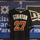 Miami Marlins' Giancarlo Stanton's jersey hangs in the Marlins dugout during a the baseball game against the Philadelphia Phillies, Saturday, Sept. 13, 2014, in Philadelphia. A leading NL MVP candidate, Stanton was struck in the face Thursday night by an