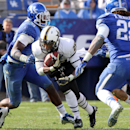 Vanderbilt's Brian Kimbrow, center, runs between Kentucky's Ashely Lowery, left, and Khalid Henderson during the fourth quarter of an NCAA college football game at Commonwealth Stadium in Lexington, Ky., Saturday, Nov. 3, 2012. Vanderbilt won 40-0. (AP Photo/ James Crisp)