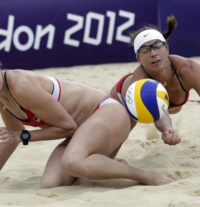 In this Aug. 7, 2012, file photo, Misty May Treanor, right, dives near her USA teammate Kerri Walsh Jennings during a women's semi-final beach volleyball match against China at the 2012 Summer Olympics in London. The World Series of Beach Volleyball, featuring athletes including Walsh Jennings, will run from July 22-27 in Long Beach, Calif