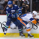 Vancouver Canucks' Brad Richardson, left, and New York Islanders' Thomas Hickey collide during the first period of an NHL hockey game Tuesday, Jan. 6, 2015, in Vancouver, British Columbia The Associated Press