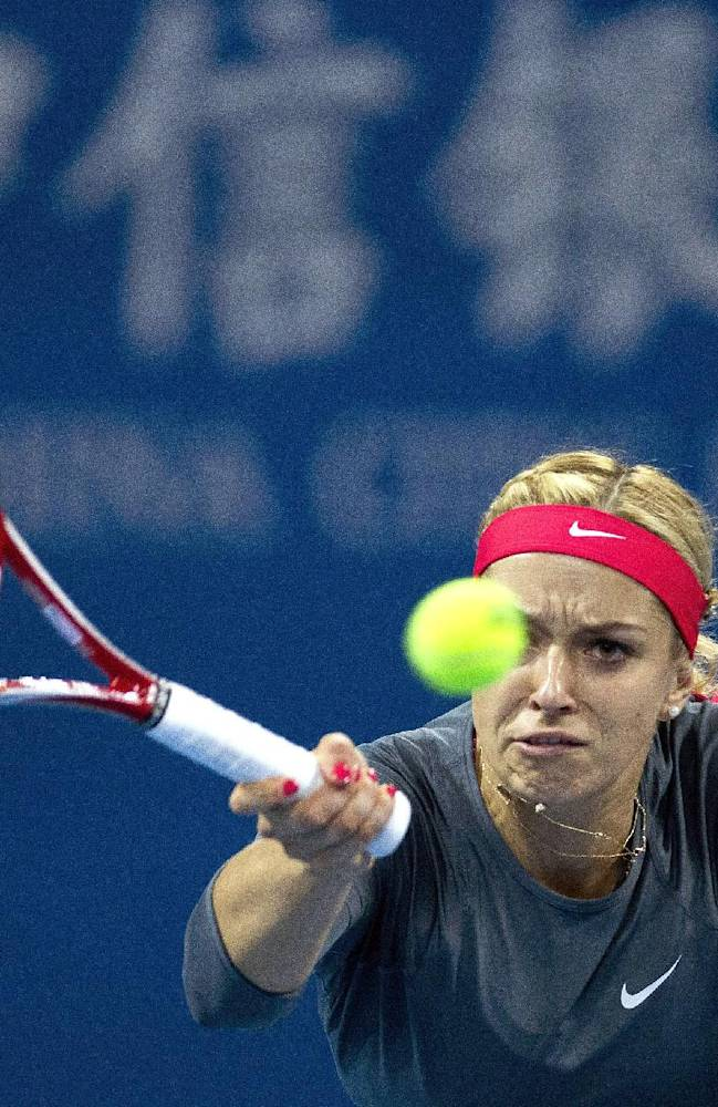Sabine Lisicki of Germany returns a shot to Li Na of China during the China Open tennis tournament at the National Tennis Stadium in Beijing, China Wednesday, Oct. 2, 2013