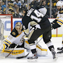Boston Bruins goalie Tuukka Rask (40) stops a shot by Pittsburgh Penguins' Chris Kunitz (14) with Zdeno Chara (33) defending during the second period of an NHL hockey game in Pittsburgh on Wednesday, Jan. 7, 2015 The Associated Press