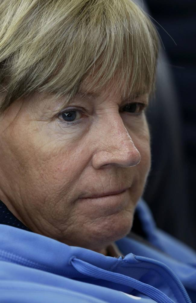 In this Wednesday, Dec. 18, 2013, photo, North Carolina women's basketball coach Sylvia Hatchell reflects on her experience with leukemia, during an interview at her home in Chapel Hill, N.C. After being diagnosed with leukemia, Hatchell has temporarily stepped away from her coaching duties to focus on her treatment