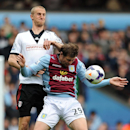 Aston Villa's Grant Holt, right, clashes with Fulham's Brede Hangeland during their English Premier League soccer match at Villa Park, Birmingham, England, Saturday April 5, 2014. (AP Photo / Joe Giddens, PA)