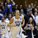 Duke's Tricia Liston (32) and Ka'lia Johnson (14) react following Liston's 3-pointer against Oklahoma State during the second half of a second-round game in the women's NCAA college basketball tournament in Durham, N.C., Tuesday, March 26, 2013. Duke won 68-59. (AP Photo/Gerry Broome)