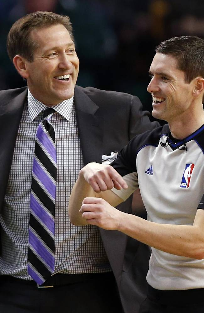Phoenix Suns head coach Jeff Hornacek has a laugh with a referee during the second half of the Suns' 87-80 win over the Boston Celtics in an NBA basketball game in Boston on Friday, March 14, 2014