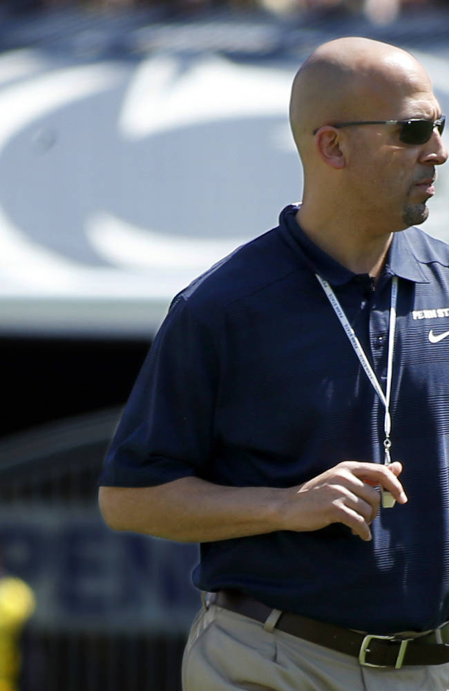 Penn State head coach James Franklin walks during the first half of the Penn State annual Blue-White NCAA college football game on Saturday, April 12, 2014, in State College, Pa