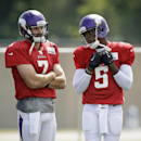 Minnesota Vikings quarterbacks Christian Ponder, left, and Teddy Bridgewater talk on the field during NFL football training camp, Sunday, July 27, 2014, in Mankato, Minn The Associated Press